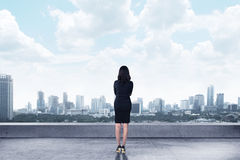Asian business woman looking to the city Stock Image