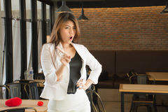 Asian business woman in a messy cafe deny / decline / say no / forbid / complain Stock Image