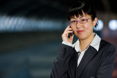 Asian business woman with mobile phone. Asian business woman posing with mobile or hand phone, modern communication Stock Photography