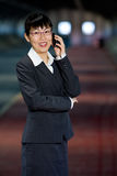 Asian business woman with mobile phone Stock Images