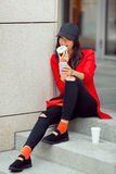 Asian business woman outdoors with food and smartphone Stock Photos