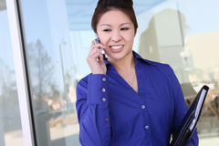 Asian Business Woman on the Phone Stock Photography