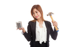 Asian business woman with pig bank and hammer Stock Photos