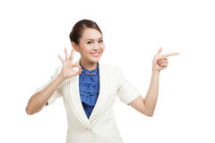 Asian business woman point to blank space and show OK sign Stock Image