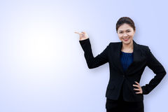 Asian business woman point up royalty free stock photos