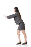 Asian business woman pushing Stock Photos