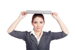 Asian business woman put a folder over her head Royalty Free Stock Photography