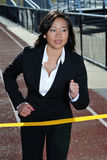 Asian business woman in a race - track Stock Image