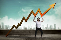 Asian business woman raise up sales chart Stock Image