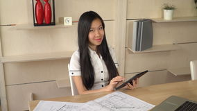 Asian business woman reading documents on the touch screen tablet. Businesswoman working in creative modern office in international company. Multicultural stock video footage