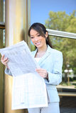 Asian Business Woman Reading Newspaper Stock Photo