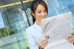 Free Asian Business Woman Reading Newspaper Royalty Free Stock Photo - 5500815