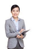 Asian business woman recording on notebook Stock Photos