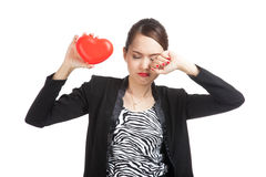 Asian business woman sad and cry with red heart Royalty Free Stock Photo