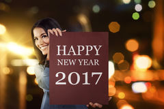 Asian business woman say happy new year 2017 Royalty Free Stock Image