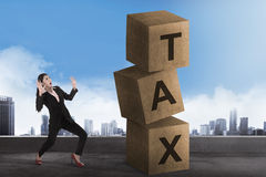 Asian business woman shock looking tax block Stock Photography