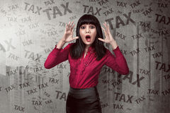 Asian business woman shocked looking the tax Royalty Free Stock Photo