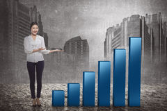 Asian business woman show increase chart Royalty Free Stock Image