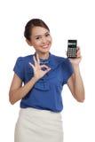 Asian business woman show OK with calculator Stock Photos