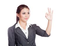 Asian business woman show OK hand sign  and smile Royalty Free Stock Photos