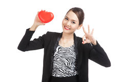 Asian business woman show OK with red heart Royalty Free Stock Image