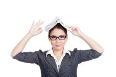 Asian business woman show OK sign with a book on her head Stock Photo