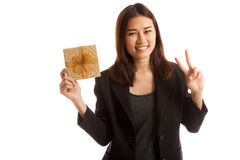 Asian business woman show victory sign with a gift box. Asian business woman show victory sign with a gift box  isolated on white background Stock Images