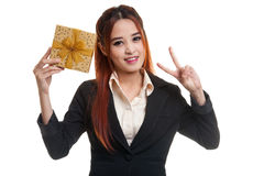 Asian business woman show victory sign with a gift box. Asian business woman show victory sign with a gift box  isolated on white background Stock Photos