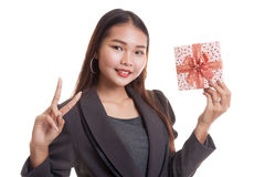 Asian business woman show victory sign with a gift box. Asian business woman show victory sign with a gift box  isolated on white background Royalty Free Stock Image
