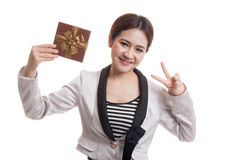 Asian business woman show victory sign with a gift box. Asian business woman show victory sign with a gift box  isolated on white background Stock Photography