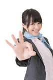 Asian business woman showing OK sign. Young asian business woman showing OK sign. Closeup portrait. Isolated on the white background Royalty Free Stock Images