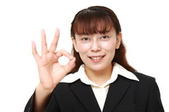 Asian business woman showing perfect sign Royalty Free Stock Photos