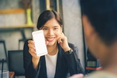 Asian business woman showing smartphone. stock images