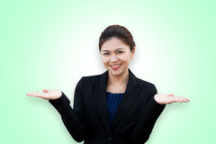 Asian business woman showing something on hand palm Royalty Free Stock Photography
