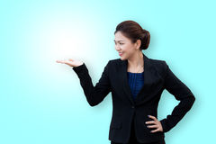 Asian business woman showing something on hand palm Royalty Free Stock Image