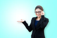 Asian business woman showing something on hand palm Royalty Free Stock Photos