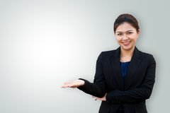 Asian business woman showing something on hand palm Stock Image