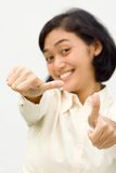 Asian business woman showing two thumbs up. Portrait of asian young business woman smiling and showing two thumbs up Royalty Free Stock Photos