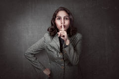 Asian business woman with silent gesture Royalty Free Stock Photo