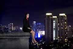 Asian business woman sit on the building rooftop Stock Images