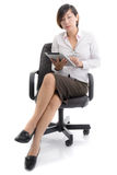 Asian business woman sitting on chair working Royalty Free Stock Images