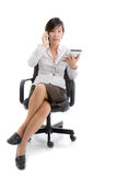 Asian business woman sitting on chair working Royalty Free Stock Image