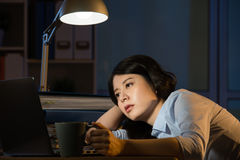 Asian business woman sleepy working overtime late night Royalty Free Stock Image