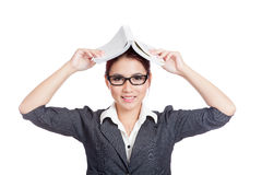 Asian business woman smile put a book over head Royalty Free Stock Photo