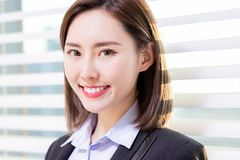 Asian business woman smile at you royalty free stock photos