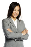 Asian business woman smiling with crossed arms Royalty Free Stock Photos