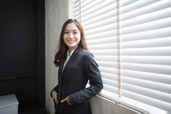 Asian business woman smiling and happy for working in the office. Asian business woman smiling happy for working in the office Royalty Free Stock Image