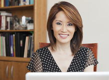 Asian business woman smiling in her office Royalty Free Stock Photography