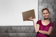 Asian business woman smiling over empty whiteboard Stock Photo