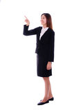 Asian business woman smiling and pointing in the air on white ba Stock Photos